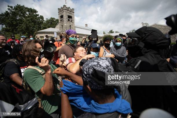 People fight over a condederate flag as anti-racist and anti-facist protesters orgranized by F.L.O.W.E.R, a frontline organization based in Atlanta...