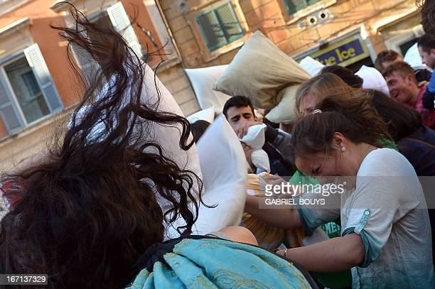 People fight with pillows as they take part in the 8th Roman annual Pillow Fight on a square in the Trastevere in Rome on April 21, 2013. AFP PHOTO /...