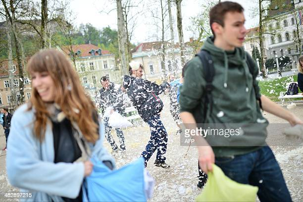 People fight with pillows during an International Pillow Fight Day in Ljubljana Slovenia on April 5 2014 AFP PHOTO / Jure Makovec