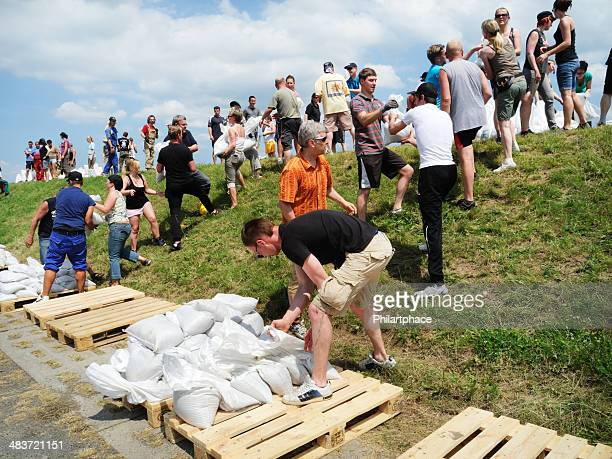 people fighting flood water - sandbag stock pictures, royalty-free photos & images