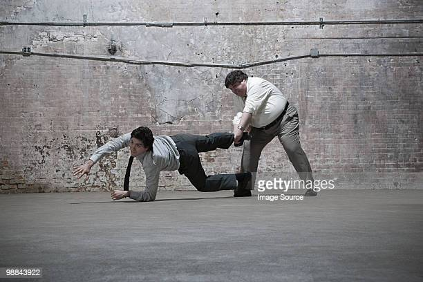 people fighting in warehouse - gripping stock pictures, royalty-free photos & images