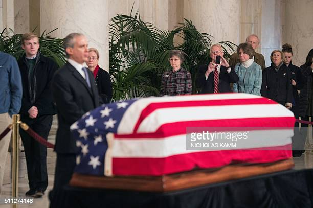 People file past the casket of US Supreme Court Justice Antonin Scalia at the Supreme Court in Washington DC on February 19 2016 where it will lie in...