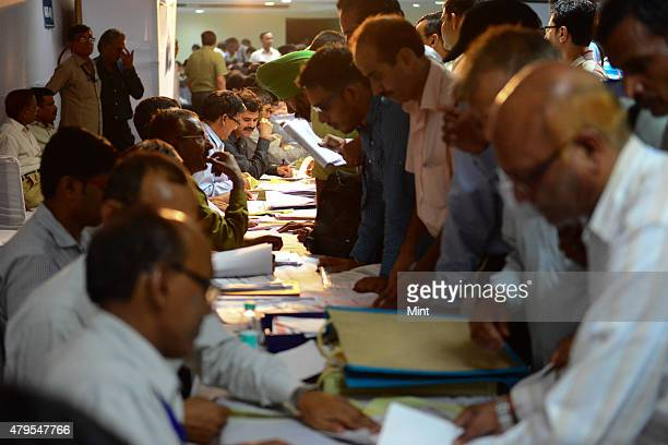 People filing their returns at the Special Return Receipt Counters at Pratyaksh Kar Bhavan on July 31 2013 in New Delhi India