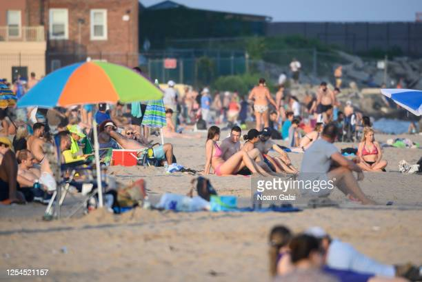 People fill Brighton Beach in Coney Island as New York City moves into Phase 2 of reopening following restrictions imposed to curb the coronavirus...