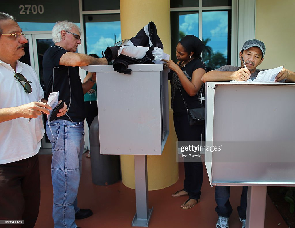 People fill out their voter registration forms at the Miami-Dade Elections Department on the final day for them to register to vote in the upcoming elections on October 9, 2012 in Miami, Florida. The Republicans and Democrats are battling it out for the election, less than a month away.