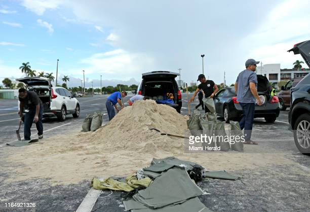 People fill sand bags at the parking of the Big Easy Casino on Friday Aug 30 2019 in Hallandale Beach Fla as they prepare for Hurricane Dorian