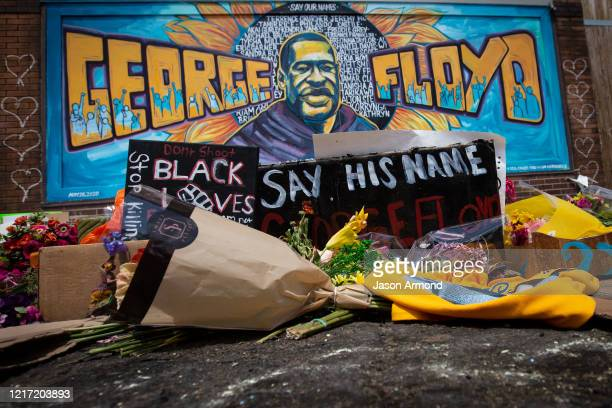 People fill the intersection in front Cup Foods where George Floyd was murdered by a Minneapolis police officer i to pay their respects at the...