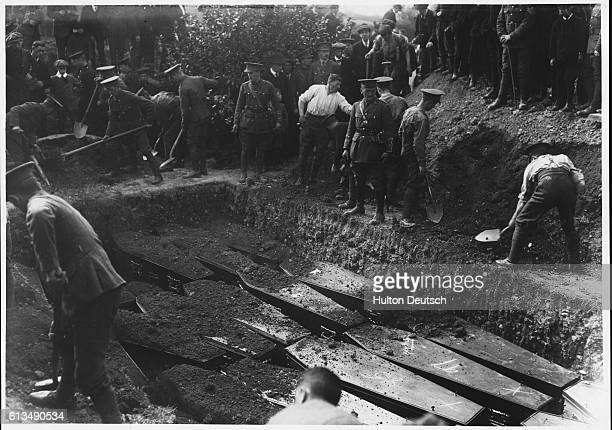 People fill the mass grave of victims of the Lusitania disaster when 1200 people were killed when German troops sank a passenger ship off the coast...
