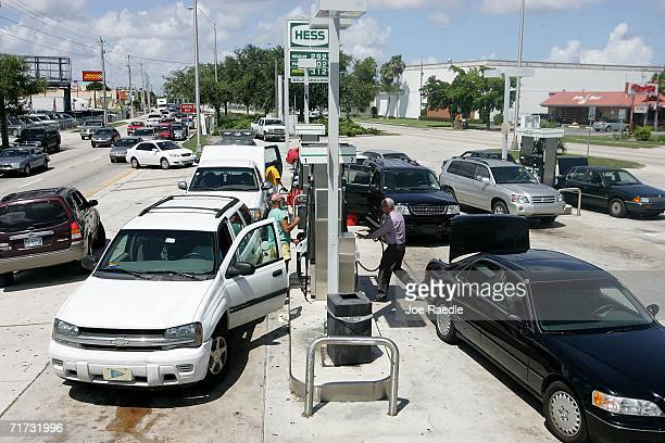 People fill their vehicles and extra fuel tanks with gas as they prepare for the approaching Tropical Storm Ernesto that is threatening South Florida...