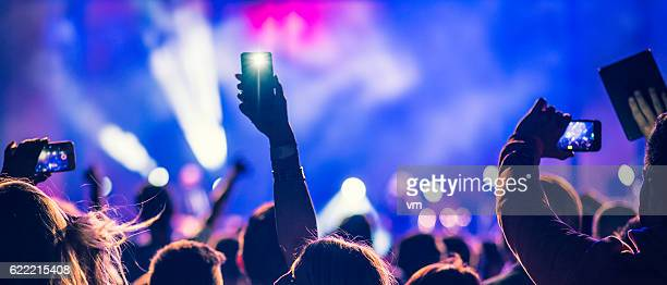 people filming a concert - photo messaging stock photos and pictures