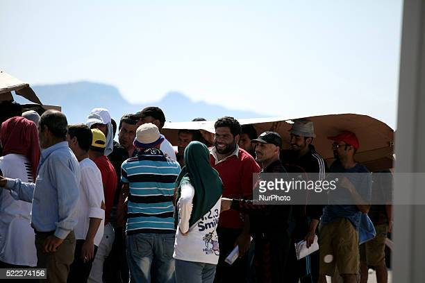 People find shadow under cartons while wait to register Refugee camp in Skaramaga area a port town 11 km west of Athens A large camp is being...