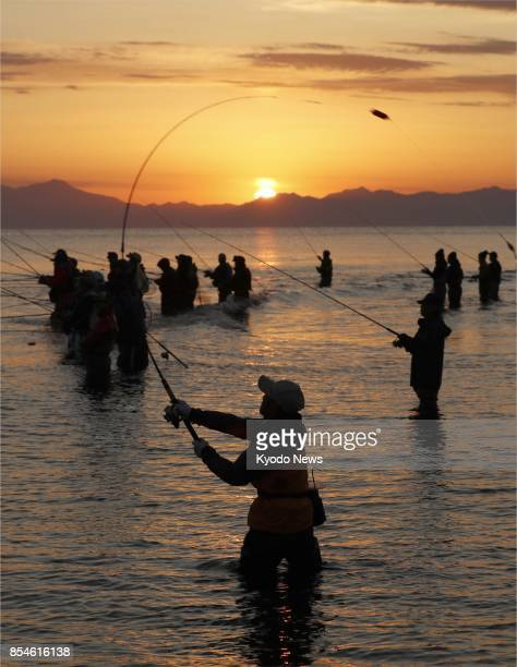 People fish for salmon on the Mokoto River in Abashiri Hokkaido on Sept 27 2017 ==Kyodo