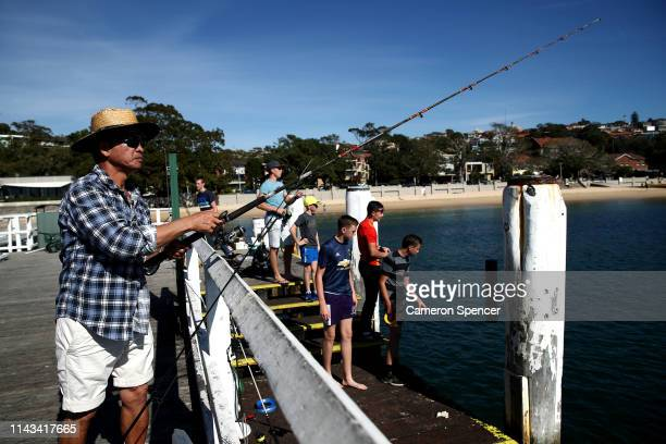 People fish from a wharf at Balmoral Beach located in the electorate of Warringah on April 18 2019 in Sydney Australia The electorate of Warringah is...