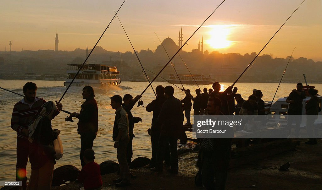 People fish in the Golden Horn November 23, 2003 in Istanbul, Turkey. Daily life is returning to normal after bomb attacks on the British consulate and the HSBC bank headquarters killed 27 people and left hundreds injured last week.