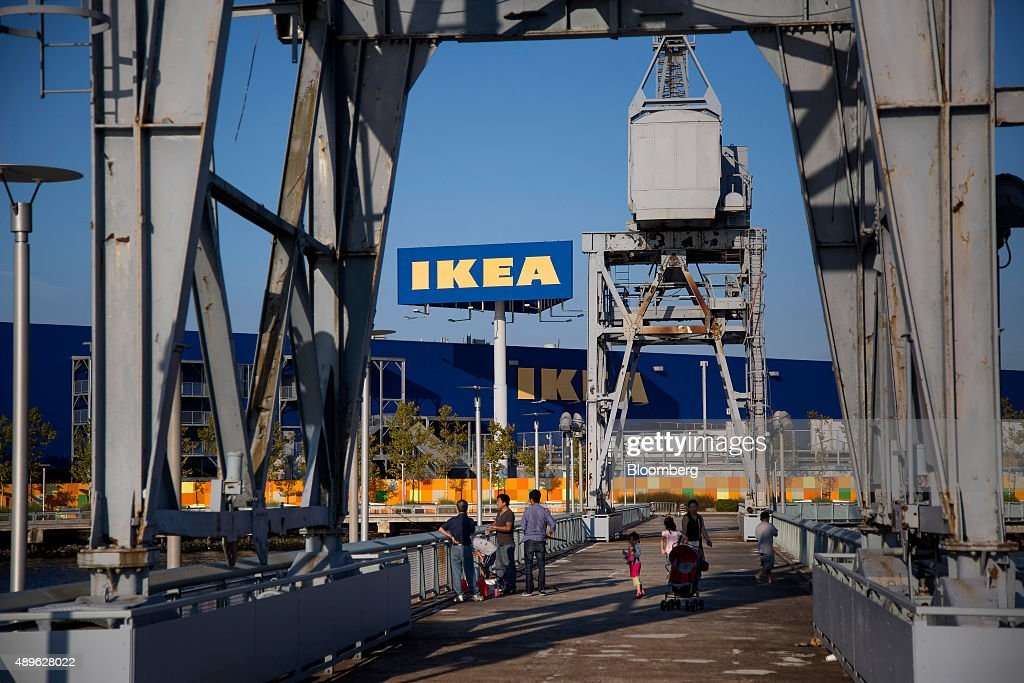 People fish on a pier behind an Ikea store in the Brooklyn borough of New York, U.S., on Saturday, Sept. 19, 2015. The U.S. Census Bureau is scheduled to release monthly durable goods data on Sept. 24. Photographer: Michael Nagle/Bloomberg via Getty Images