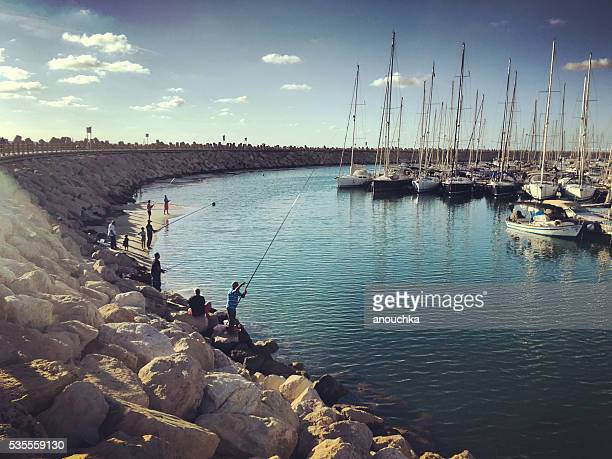 People fishing at Herzliya Marina, Tel Aviv, Israel