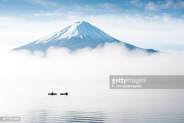 people fishing at kawaguchiko lake in the morning - mount fuji stock photos and pictures