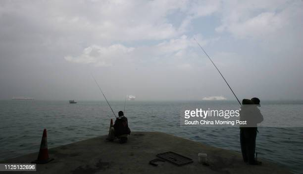 People fishing at Quarry Bay Fog at Victoria Harbour all area A humid maritime airstream is bring foggy weather to the South china coastal waters...