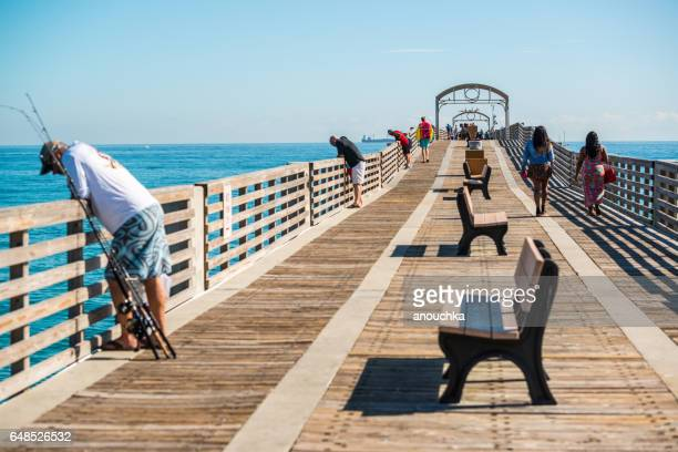 People fishing from the pier, Lake Worth Beach, Florida, USA