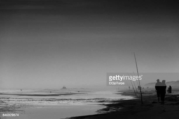 People fishing in beach at dawn, Punta del Este, Uruguay