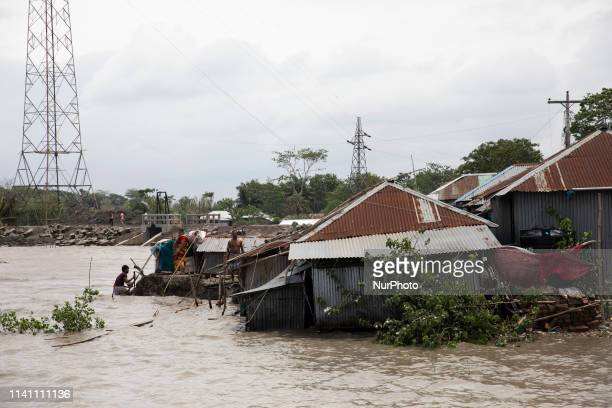 People fix their damaged homes amid high waters in Khulna on May 4 as Cyclone Fani reached Bangladesh Cyclone Fani one of the biggest to hit India in...