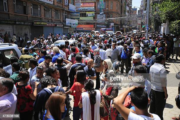 People fled into the streets after a magnitude 73 earthquake has hit Nepal as the country recovers from last month's devastating earthquake in...
