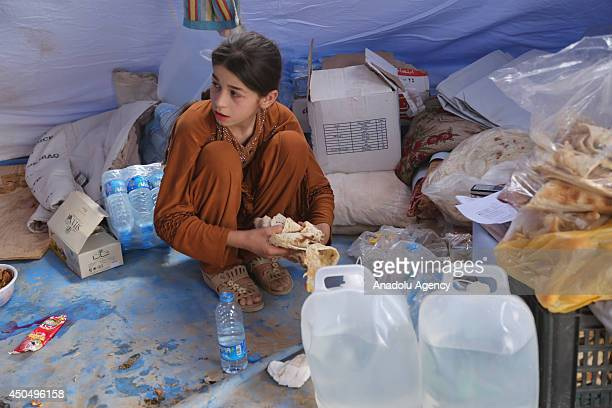 People fled Mosul seized by Islamic State in Iraq and the Levant after the clashes between Iraqi security forces and ISIL start to live in Hazer camp...
