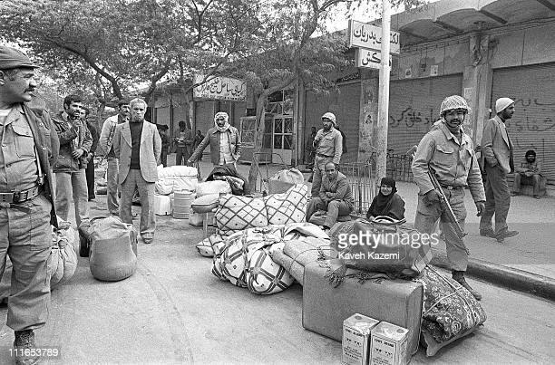 People flee Abadan, Iran, with their belongings after intensive Iraqi shelling of the city, 10th December 1980.