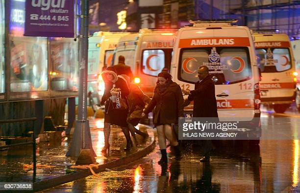 People flee as ambulances are on the attack site on January 1 2017 in Istanbul At least two people were killed in an armed attack Saturday on an...