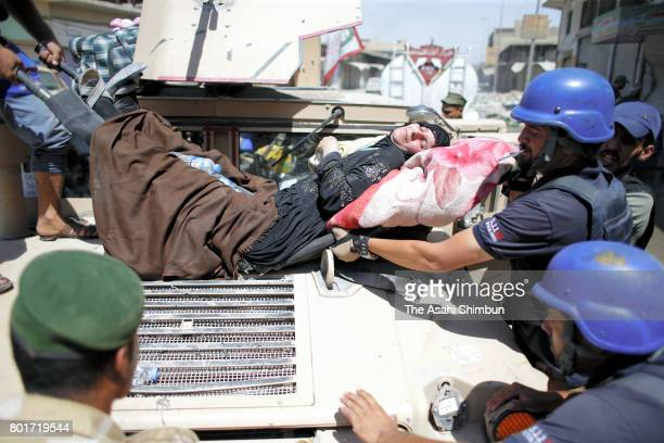 People fleed by the Iraqi force from the Islamic States controlled area are seen on June 23 2017 in Mosul Iraq Iraqi forces continue to encounter...