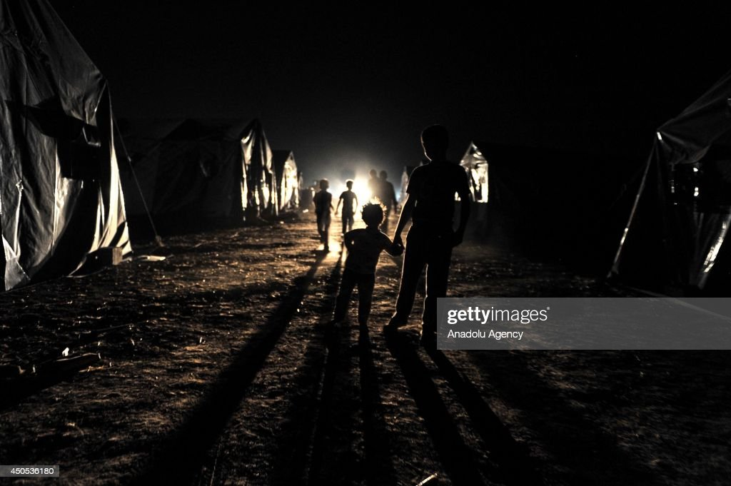 People, fleeing Mosul to the safe zones due to the clashes between Islamic State in Iraq and the Levant (ISIL) members and Iraqi security forces, in Mosul, Iraq on June 13, 2014. People have hard time at Hazer camp, built by United Nations and regional government near Arbil, due to the sandstorm.