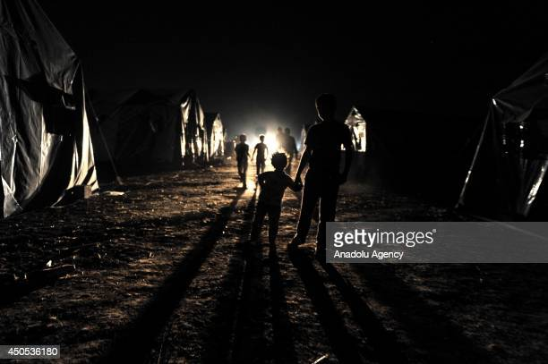 People, fleeing Mosul to the safe zones due to the clashes between Islamic State in Iraq and the Levant members and Iraqi security forces, in Mosul,...