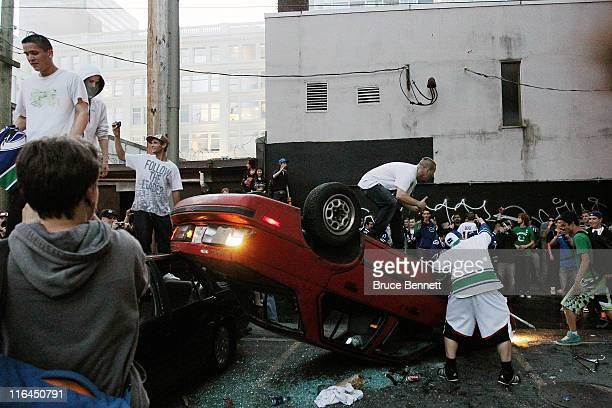 People flip a vehicle on June 15 2011 in Vancouver Canada Vancouver broke out in riots after their hockey team the Vancouver Canucks lost in Game...