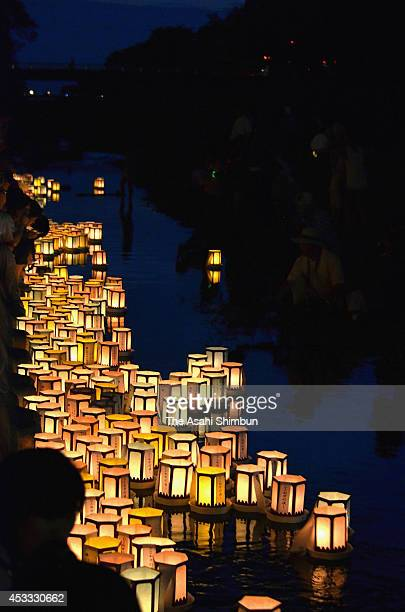People float candlelit lanterns during the Hikone Manto Nagashi on August 7 2014 in Hikone Shiga Japan 1000 lanterns are floated to pray for ancestors