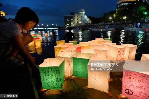 People float candlelit paper lanterns on Motoyasugawa River to pray for the ABomb vicitims on the 73rd Anniversary of Hiroshima ABomb dropping on...