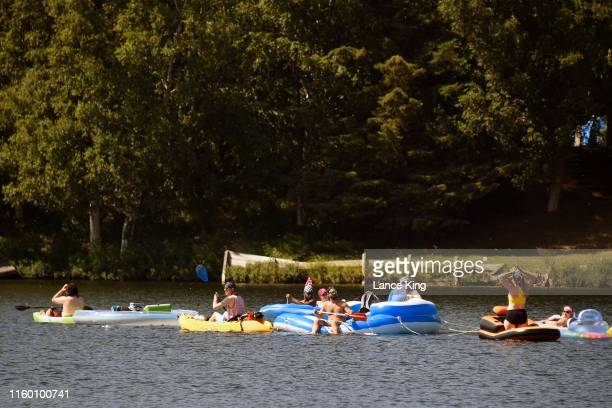 People float on inflatable rafts at Jewel Lake on July 4 2019 in Anchorage Alaska Alaska is bracing for record warm temperatures and dry conditions...