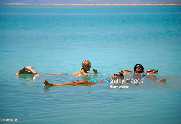People floating in Dead Sea, Crowne Plaza Hotel