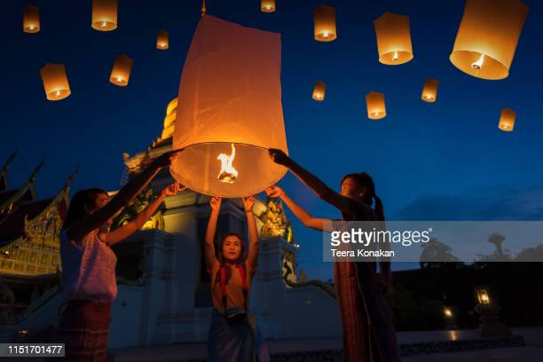 people floating lamp in yi peng festival in chiangmai thailand - yi peng stock pictures, royalty-free photos & images
