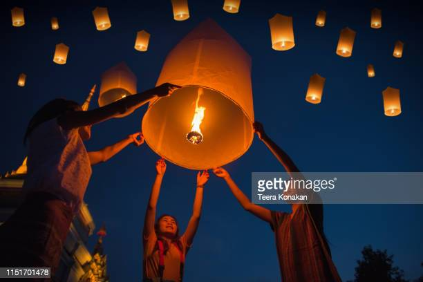 people floating lamp in yi peng festival in chiangmai thailand - tradition stock pictures, royalty-free photos & images