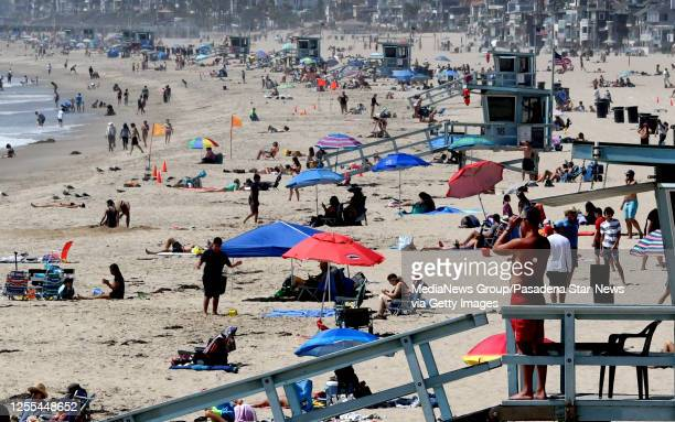 People flock to the beach in Hermosa Beach on Wednesday, July 8, 2020.