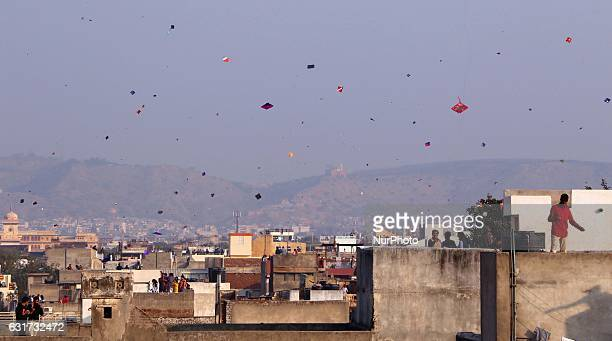 People fly kites in the sky at walled city on the occasion of Makar Sankranti in Jaipur Rajasthan India 14 Jan2017Makar Sankranti marks the beginning...