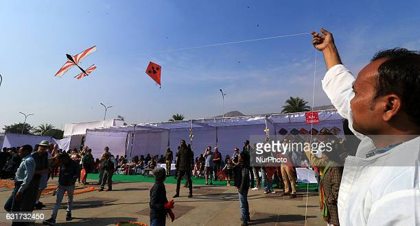 People fly kites in the sky during the Kite Festival on the occasion of Makar Sankranti at Jal Mahal in Jaipur Rajasthan India 14 Jan2017Makar...