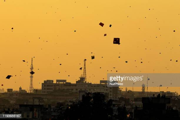 People fly kites in the sky on the occasion of the Makar Sakranti at walled city area of Jaipur Rajasthan India Jan 14 2020