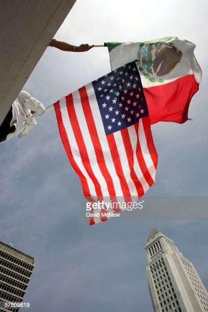People fly the flags of Mexican and the US near City Hall during a rally on what is dubbed a Day Without Immigrants or the Great American Boycott day...