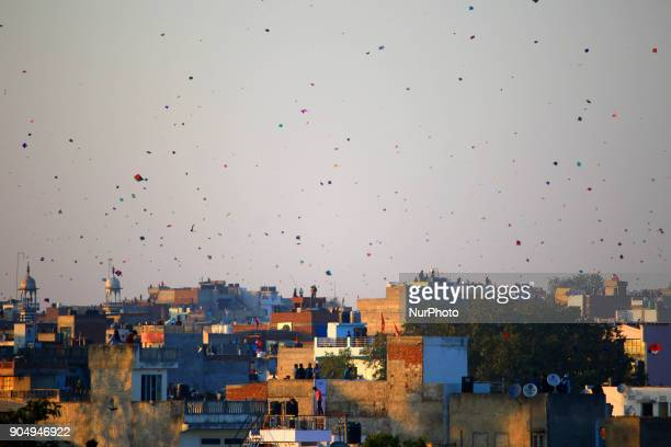 People flying kites on the occasion of Makar Sakranti at wall city of Jaipur RajasthanIndia on 14 January 2018