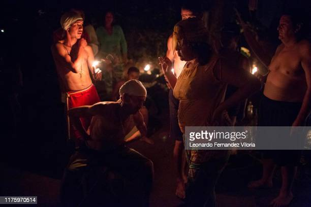 People following Maria Lionza go into a trance for different spirits at night during a spiritual ritual in a portal deep in the mountain of sorte on...