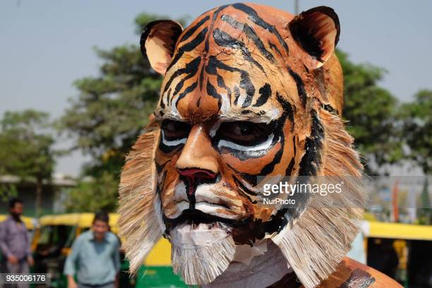 People for the Ethical Treatment of Animals member bodypainted as a tiger stands to promote vegan eating ahead of International Day of Forests in New...