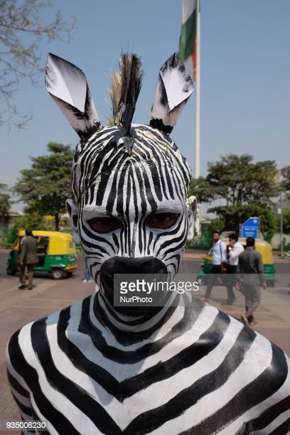 People for the Ethical Treatment of Animals member bodypainted as a zebra promotes vegan eating ahead of International Day of Forests in New Delhi on...
