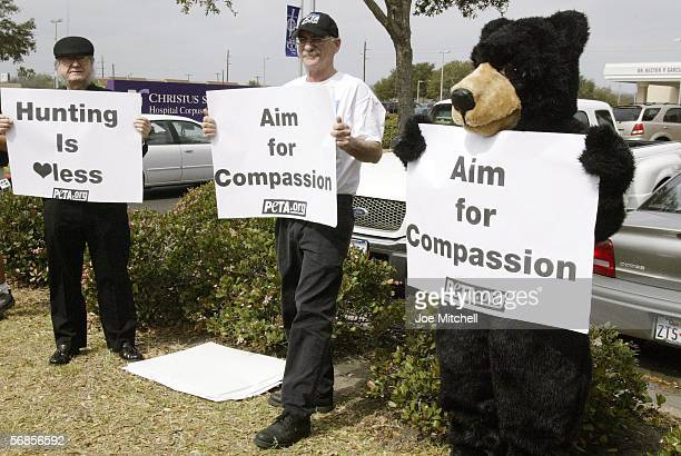 People for the Ethical Treatment of Animals members William Scott of Corpus Christi and Bob Chorush of Seattle, Washington, display signs outside...