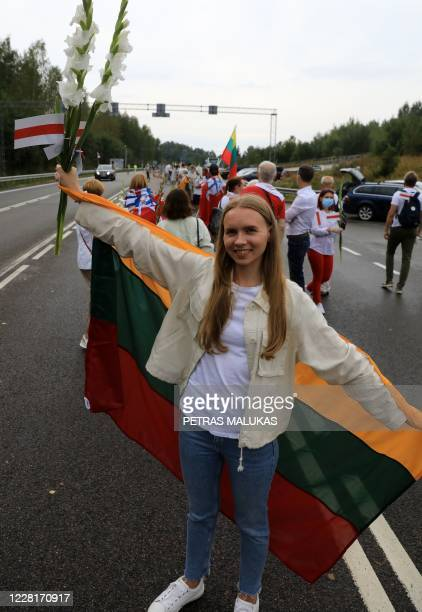 People form a human chain from Vilnius to Medininkai along the border with Belarus to show solidarity with the Belarussian people in Medininkai...